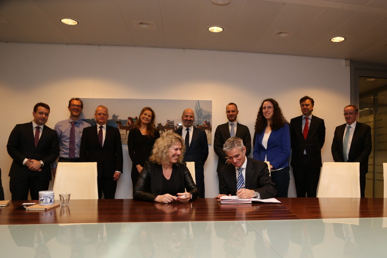 Munich Re and FMO sign a USD 500 million Risk Sharing Framework Agreement to scale up impact investing